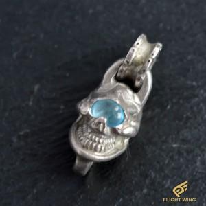 Single Skull Top and Blue Topaz Eye / Stop Light